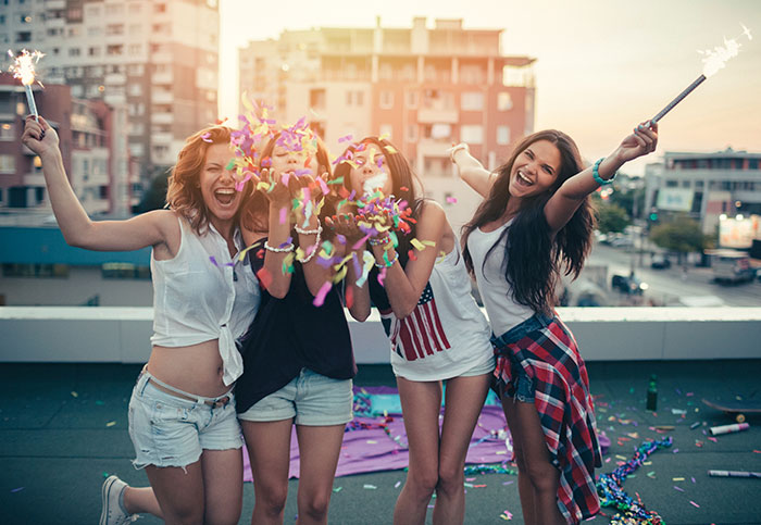 Group of girls having fun on a rooftop